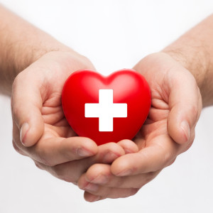 Male Hands with Red Heart | Crandall Law Group | Hayden, Idaho
